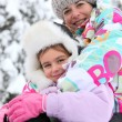 Mother with her child on a winter's day — Stock Photo