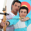 Teenage boy archery lesson — Stock Photo #11033323