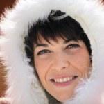 Woman wearing fur hood — Stock Photo