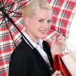 Portrait of a young woman with umbrella — Stock Photo #11033425