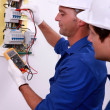 Electrician measuring current — Stock Photo