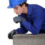 Tradesman holding a plumb line — Stock Photo #11033753