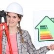 A female construction worker promoting energy savings. - Foto Stock