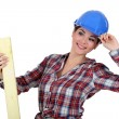 Woman with plank of wood — Stockfoto