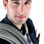 Tradesman carrying corrugated tubing around his shoulder — Stock Photo #11034228
