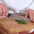 Chopping parsil. - Stockfoto