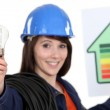 Woman holding energy rating poster and light bulb — Stock Photo #11034742