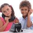 Children on the phone - Stock Photo