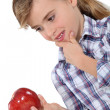 Little girl holding apple — Stock Photo