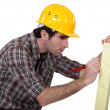 Man marking wood - Stock Photo