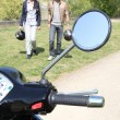 Couple near a motorbike — Stock Photo #11036104