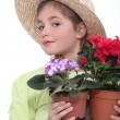 Girl with potted plants — Stockfoto