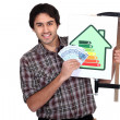 Stock Photo: Man holding an energy consumption label and a lot of money in cash
