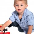 A little boy playing with a car. — Stock Photo #11036726