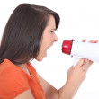 Woman screaming into a megaphone — Stock Photo #11036962
