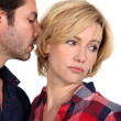 Husband kissing unhappy wife — Stock Photo