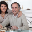 Married couple playing chess together — Stock Photo
