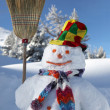 Funny snowman holding broom stick — Stock Photo