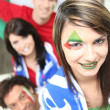 Stock Photo: Group of friends supporting Italifootball team