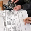 Architects making calculations - Stock Photo