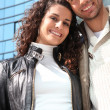 Couple in front of building — Stock Photo #11039620
