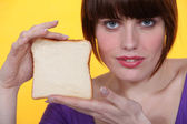 Woman with white bread — Stock Photo