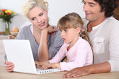 Parents with daughter and computer — Foto Stock