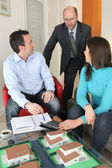 Couple having a meeting with their architect — Stock Photo