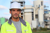Man in a reflective jacket on site — Stock Photo