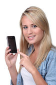Girl holding phone — Stock Photo