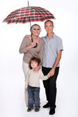 Grandparents posing with their grandchild — Stock Photo