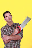 Man holding a saw — Stock Photo