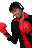 Businesswoman wearing boxing gloves — Stock Photo