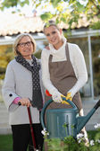 Helping elderly woman in the garden — Stock Photo