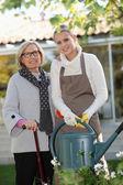 Helping elderly woman in the garden — Stock Photo