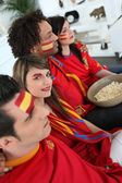 Spanish football fans watching a game at home — Stock Photo