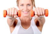 Woman using hand weights during fitness session — Stock Photo