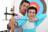 Teenage boy archery lesson — Stock Photo