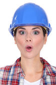 Female worker with look of surprise on face — Stock Photo
