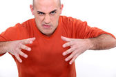 Angry young bald man — Stock Photo