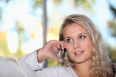 Blonde woman on the phone — Stock Photo