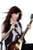 Woman singing with a guitar — Stock Photo