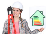 A female construction worker promoting energy savings. — Stock Photo