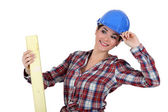 Woman with plank of wood — Stock Photo