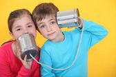 Children playing with tin cans — Stock Photo