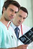 Medical staff examining echography — Stock Photo