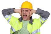 Workers covered their ears — Stock Photo