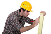 Man marking wood — Stock Photo