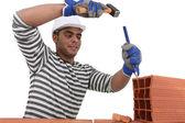 Mason using chisel on brick — Stock Photo