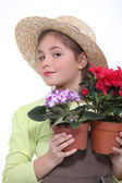 Girl with potted plants — Stock Photo